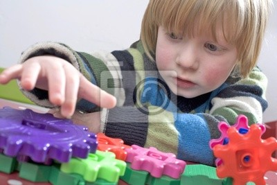 young child learning with some colourful cogs