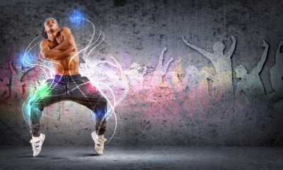 Canvas print young man dancing hip hop with color lines