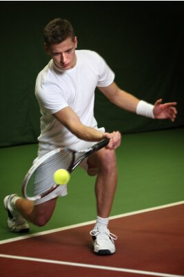 Canvas print Young man playing tennis