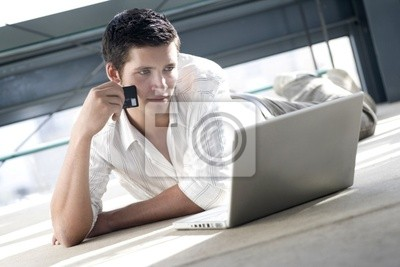 young man shopping and browsing on line