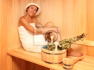 Canvas print Young woman in a steam bath-room