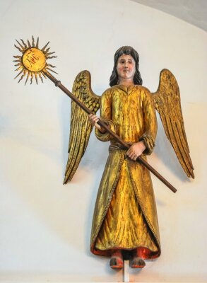 16th century. Old Russian wooden sculpture of a Christmas angel.