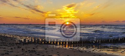 Wall mural A beautiful sunset over the sandy beach on the Wolin Island in Poland in the winter