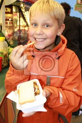 A little boy eating fresh baked mushrooms