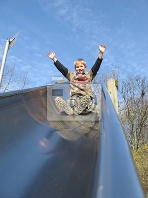 A little boy on a slide