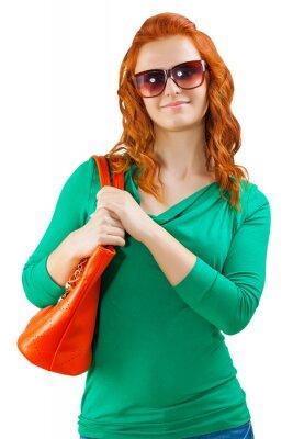 a red head girl with handbag