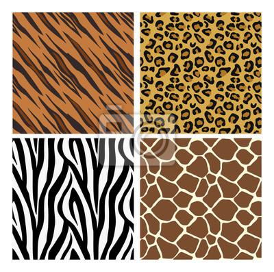 A set of animal print seamless pattern tile backgrounds. Tiger, giraffe, zebra and cheetah skins.