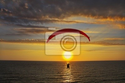 Above the sea on a sunset