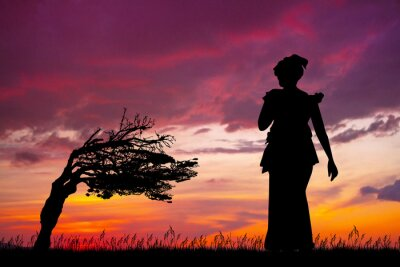 Wall mural African woman at sunset