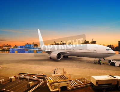 Wall mural air freight and cargo plane loading trading goods in airport container parking lot use for shipping and air transport logistic industry
