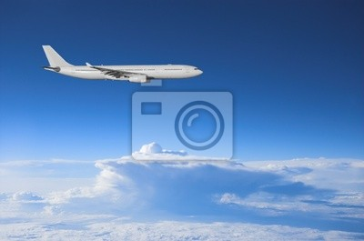 Airliner high above the weather