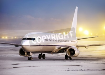 Wall mural airport and white plane at non-flying weather, winter time