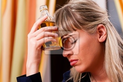 Alcohol and Abuse - Woman drinking too much brandy