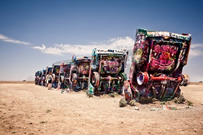 Wall mural AMARILLO, TEXAS - JULY 10: Famous art installation of the old Cadillac cars on July 10, 2011 at Cadillac Ranch near Amarillo, Texas. It was created in 1974 by Chip Lord, Hudson Marquez and Doug Michel