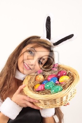 An Easter bunny is happy about his Easter eggs