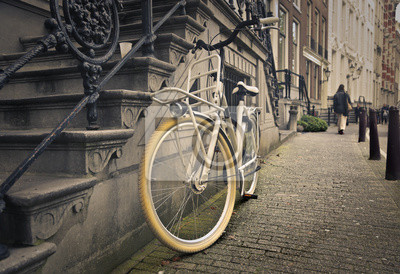 an old bicycle in a grey street
