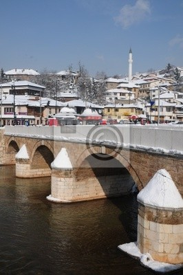 Wall mural An old bridge in Sarajevo during the winter