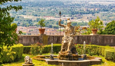 Ancient fountain decorated with  statue of  ancient goddess Athena