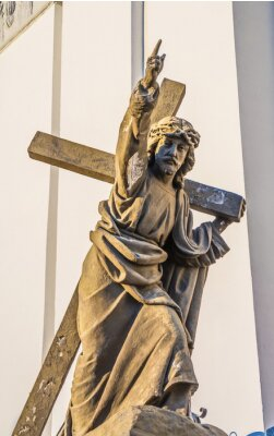 Ancient statue of Jesus carrying cross