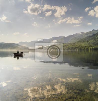 angler on the boat, the Slovenian lake Bochinjskie