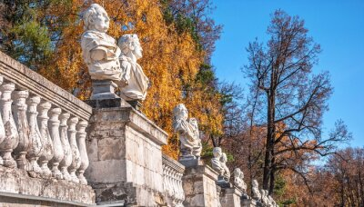 Antique busts of ancient Roman philosophers and emperors on  old terrace of  autumn park