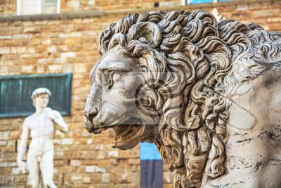 Antique sculpture -  head of  ferocious lion