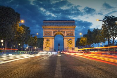 Wall mural Arc de Triomphe. Image of the iconic Arc de Triomphe in Paris city during twilight blue hour.