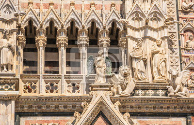 Architectural fragment with sculptures of  Siena Cathedral in honor of  Ascension of  Blessed Virgin Mary