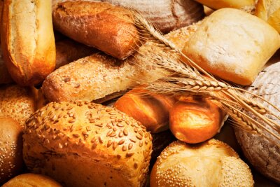Wall mural assortment of baked bread with wheat