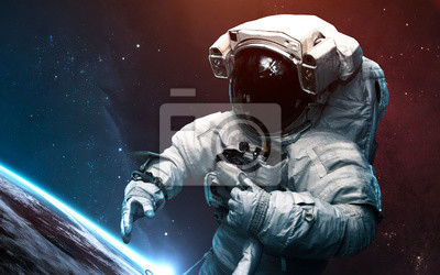 Astronaut against Earth planet. Science fiction art. Elements of this image furnished by NASA