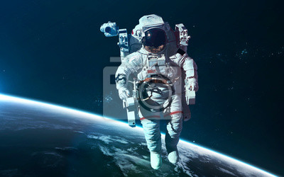 Astronaut at Earth orbit. Science fiction wallpaper. Elements of this image furnished by NASA