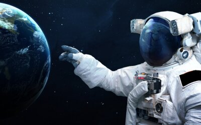 Wall mural Astronaut in outer space. Spacewalk