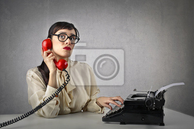 At the telephone