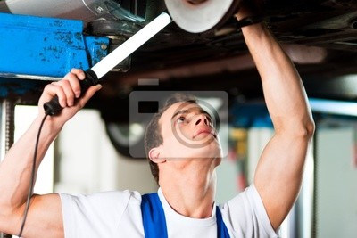 Auto mechanic in his workshop
