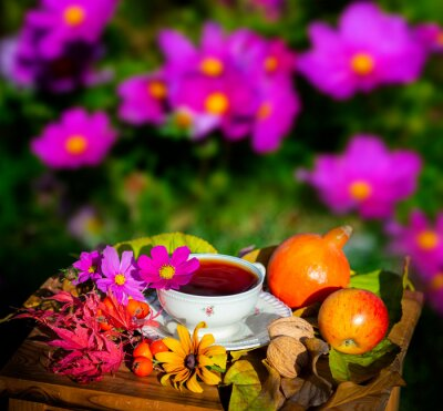autumn still life with a cup of tea in the garden
