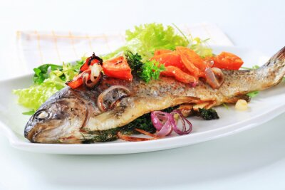 Wall mural Baked trout with tomatoes and green salad