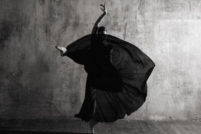 Wall mural Ballerina in ballroom. Ballet dancer in studio. Black and white monochrome.