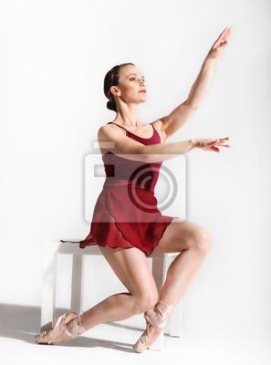 Ballet dancer posing on studio background