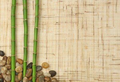 Wall mural bambou et cailloux sur fond de toile de jute