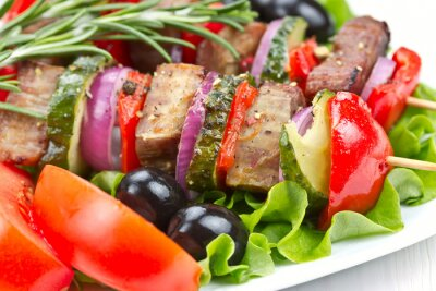 Barbecue meat on skewers with vegetables