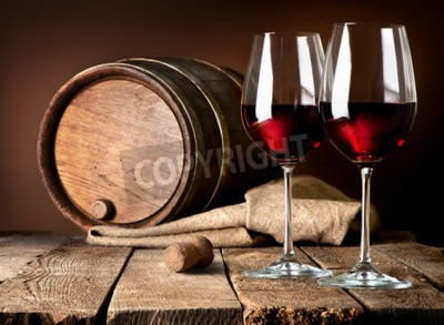 Wall mural Barrel and wineglasses of red wine on a wooden table