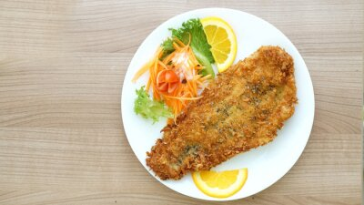 Wall mural battered fish steak with salad and vegetable