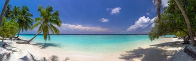 Wall mural Beach panorama at Maldives with blue sky, palm trees and turquoi
