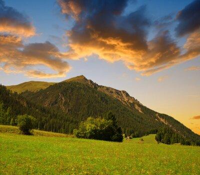 Beautiful Alpine landscape with mountain range at sunset. Canton Graubunden in Switzerland.