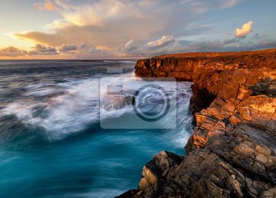 beautiful and dramatic sunset on a craggy rocky cliff, Jandia Peninsula, Fuertaventura