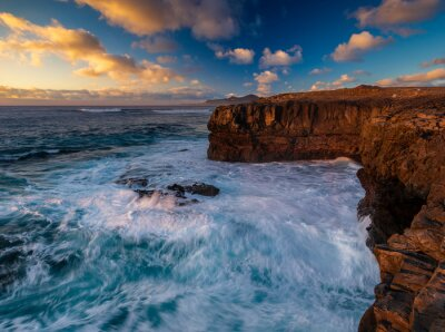 Wall mural beautiful and romantic sunset on the rocky cliffs of Fuerteventura
