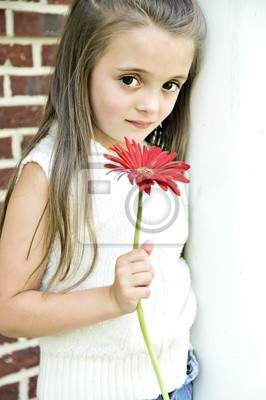 Beautiful Child holding a red flower in her hand.