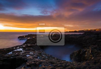 Beautiful, dramatic sunrise over the rocky coast of the ocean.Bufadero de La Garita (Gran Canaria)