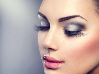 Wall mural Beautiful fashion luxury makeup. Long eyelashes, perfect skin