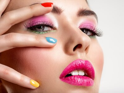 Wall mural Beautiful fashion woman with a colored nails. Attractive white girl with multicolor manicure.